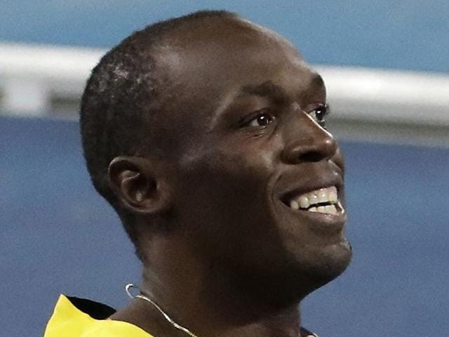 Usain Bolt of Jamaica poses next to the electronic result board after winning the gold medal in the race.