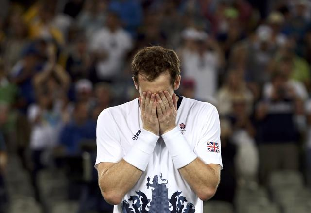 World No. One Novak Djokovic, left, lost his Olympic opener to Juan Martin del Porto before leaving the court in tears.