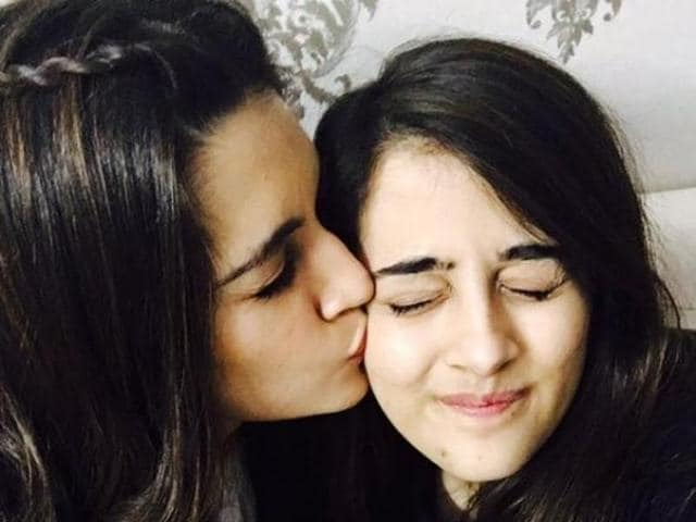 Actor Kriti Sanon (L) and sister Nupur tie rakhis to each other.