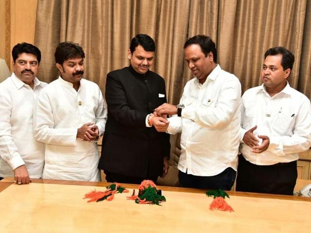 City BJP chief Ashish Shelar (second from right) ties a symbolic thread on chief minister Devendra Fadnavis' (third from left) hand on Monday.