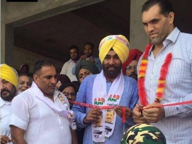 Wrestler Dalip Singh Rana, popularly known as Great Khali, with AAP candidate Sajjan Singh Cheema inaugurating his election office in Sultanpur Lodhi on Sunday.