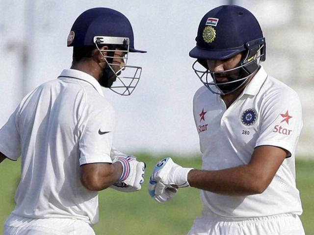 India's batsmen Ajinkya Rahane, left, and India's Rohit Sharma greet during day four of their third Test match.