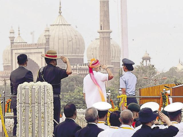 Prime Minister Narendra Modi greets students who participated in the I-Day celebrations at Red Fort.