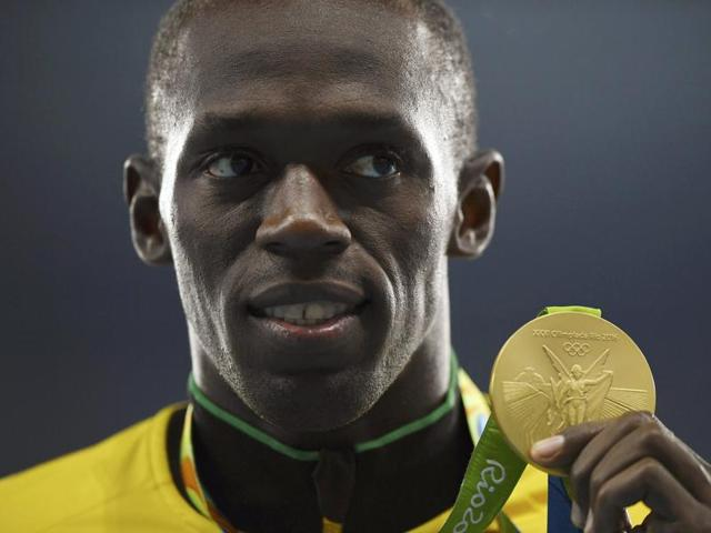 100m gold medallist Usain Bolt of Jamaica poses after the medal ceremony in Rio on Monday.