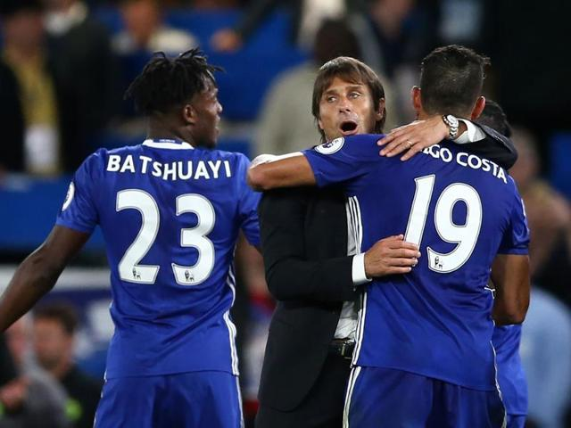 Chelsea coach Antonio Conte (left) had Diego Costa (right) to thank for a winning start to their Premier League campaign.