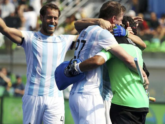 Argentina's Joaquin Menini, left, celebrates with teammates his goal against Germany.