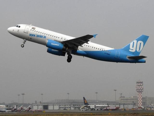 A Blue GoAir aircraft takes off at Mumbai Airport.