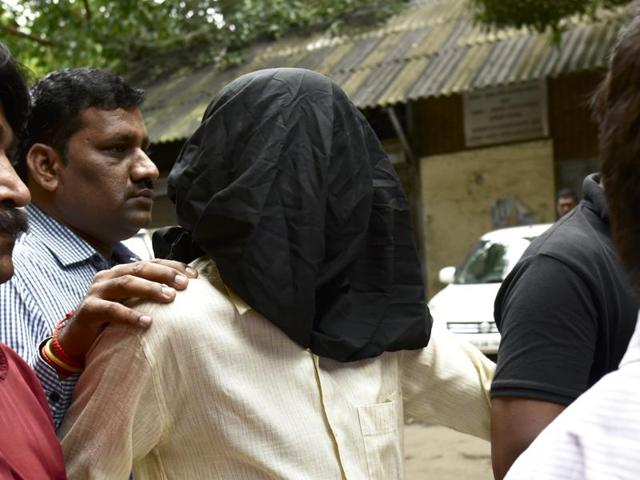 Mohammad Hanif being produced in court.(Arijit Sen/HT PHOTO)