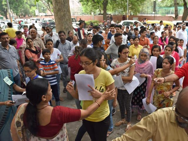 The students queue up to enter the examination hall to take NEET Exam at Kerala School in New Delhi on July 24, 2016.