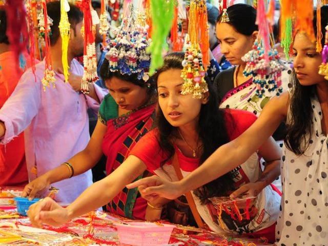A girl selects a rakhi at one of the shops in Lajpat Nagar market.
