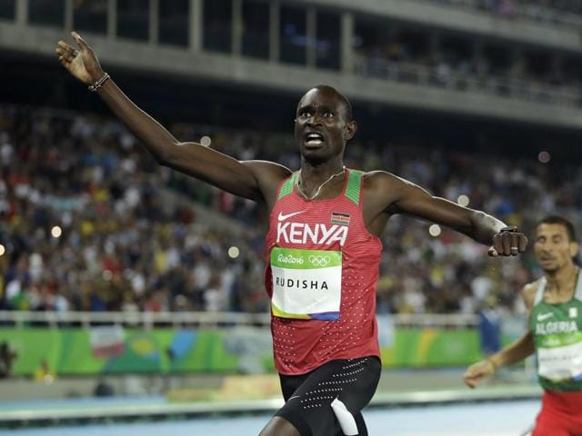 Kenya's David Rudisha celebrates after winning the men's 800m final ahead of Algeria's Taoufik Makhloufi (left) at the Olympic Stadium in Rio de Janeiro on Monday.