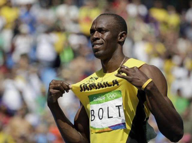Usain Bolt topped his heat with a 20.28-second effort.