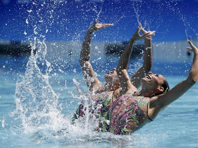 Mexico's Karem Faride Achach Ramirez and Nuria Lidon Diosdado Garcia compete during the synchronized swimming duet free routine preliminary round in the Maria Lenk Aquatic Center at the 2016 Summer Olympics in Rio de Janeiro, Brazil.