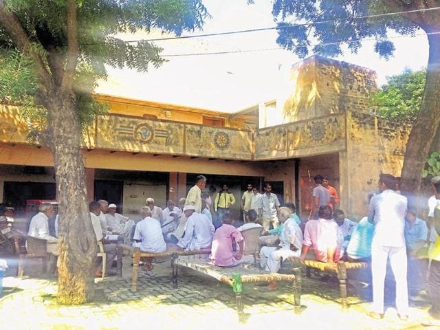 Villagers assemble at the couple's house after the murder last week in Badalpur. The accused, Pramod (45), allegedly strangulated the couple on the night of August 1 with the help of his servant Salman.