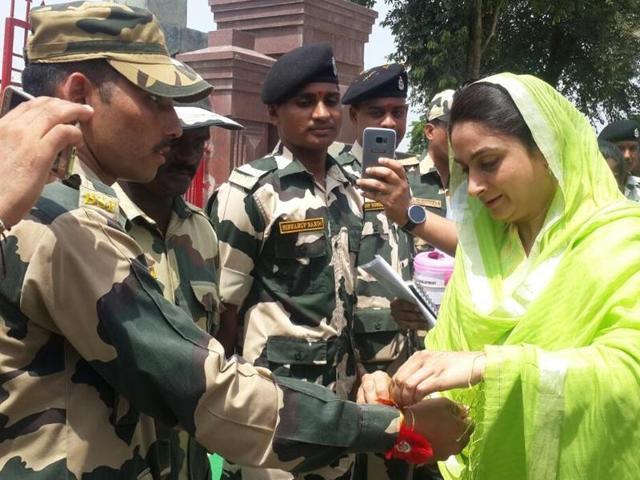 Union minister for food processing Harsimrat Kaur Badal  tying rakhi to BSF trooper.