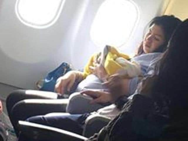 Flight attendants and nurses cleaned the baby with mineral water and dressed her in baby clothes donated by fellow passengers flying with infants