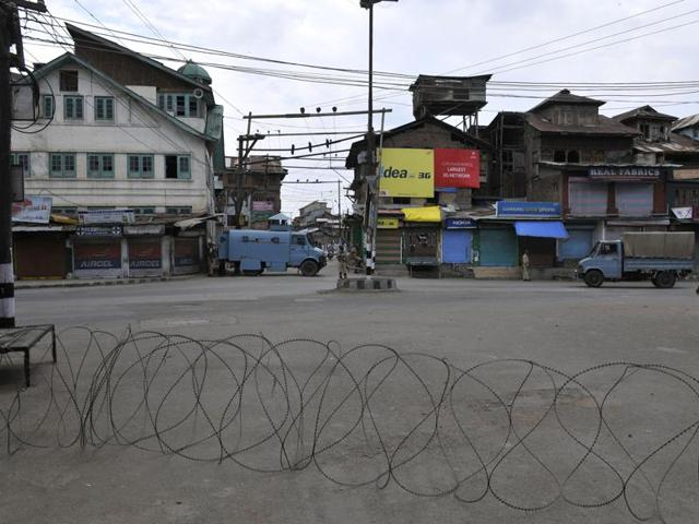 Paramilitary soldiers stands guard during curfew in downtown area of Srinagar,India, 11 August 2016.