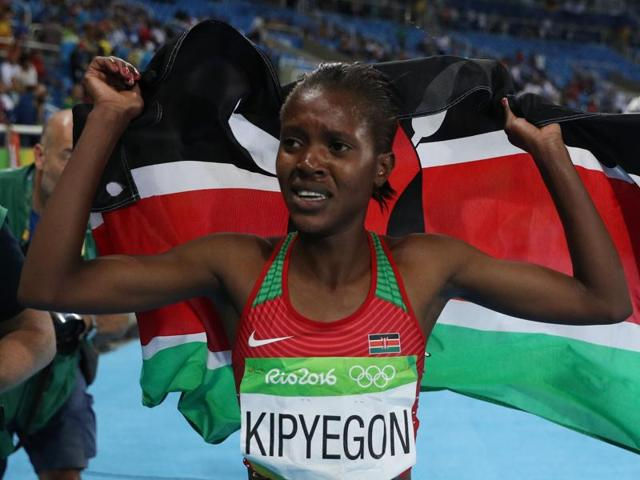 Faith Chepngetich Kipyegon of Kenya celebrates after winning the gold ahead of world champion Genzebe Dibaba  Ethiopia.