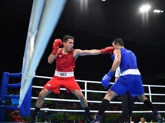 Mexico's Misael Rodriguez (left) beat Egypt's Hosam Abdin in the men's 75kg category to reach the  semifinals.