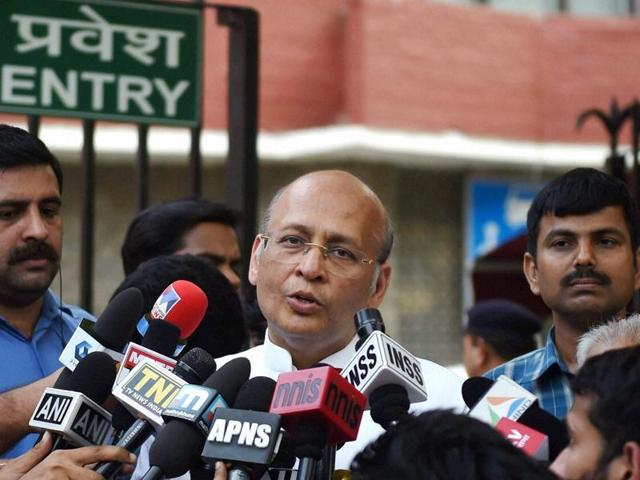 Congress leader Abhishek Manu Singhvi interacts with media persons in New Delhi.