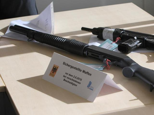 Weapons seized by the police in connection with the detention of a dealer involved in the July rampage in a Munich shopping centre are pictured prior to a press conference on August 17, 2016 at the main customs office in Frankfurt am Main, western Germany.