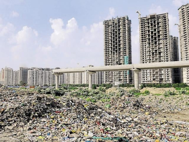 In the absence of a proper waste disposal mechanism, authorities in Noida and Greater Noida have been dumping solid waste in open spaces.