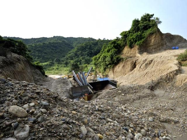 Two hillocks stood here until this stone crusher started cutting the Shivalik foothills of Sukhchainpur village near Talwara in Hoshiarpur district.