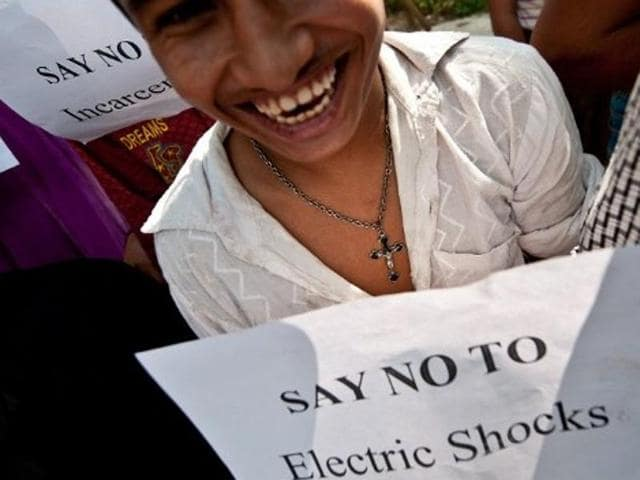 A mentally challenged youth holds a placard during a protest outside the Indian Health Ministry in New Delhi.
