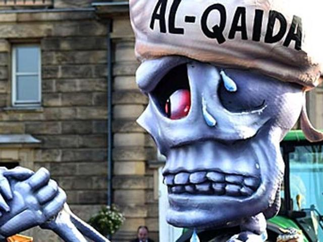 Figures depicting al-Qaeda are pictured  during the traditional Rose Monday carnival parade in the western German city of Duesseldorf.