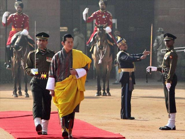 King of Bhutan, Jigme Khesar Namgyel Wangchuck, inspects the guard of honour during a ceremonial reception at the Rashtrapati Bhawan in New Delhi.
