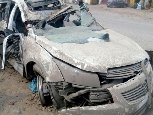 The remains of the car that met with an accident as it the driver lost control after bumping into a pothole in Tarn Taran.