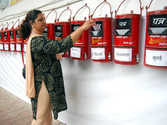A woman shops for 'Rakhi' ahead of the Raksha Bandhan festival in Jammu on August 16, 2016. Given the tensions between India and Pakistan, siblings split across the border are sending their Rakhis via neutral countries like UK and Saudi.