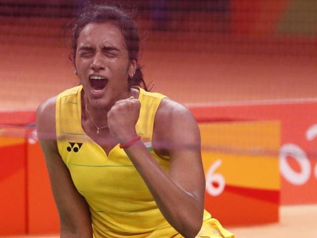 PV Sindhu celebrates after winning her match against Yihan Wang.