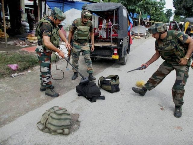 Army personnel look for explosives from bags recovered Balajan Tinali area near Kokrajhar town in Assam.