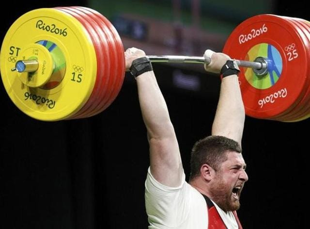 Lasha Talakhadze of Georgia exults after winning gold in 105-plus weight category.