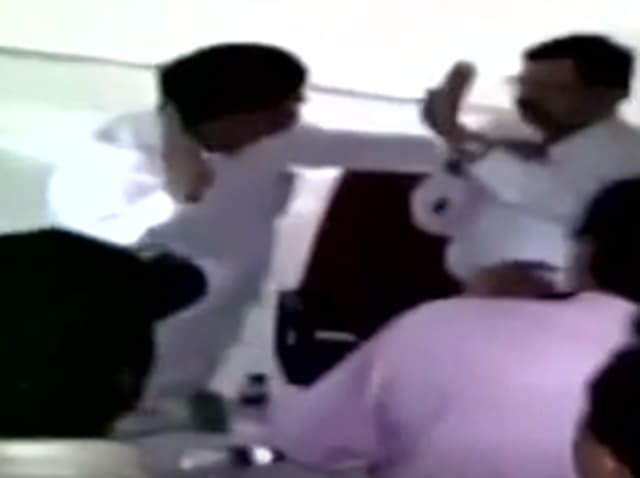A video grab shows the brawl between the MLA and the deputy collector.