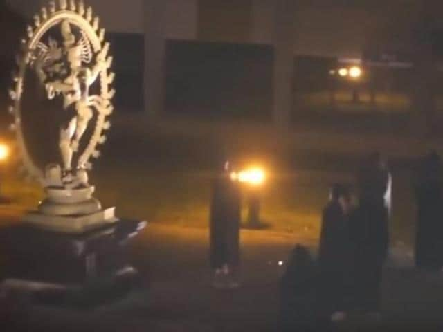 A bizarre video has been circulated online showing several people at a main square at Europe's top physics lab for a re-enactment of an occult ceremony. Lab authorities have opened an investigation.