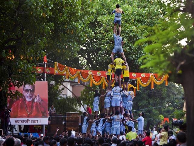 Devotees form a human pyramid to mark the dahi handi festival in Dadar in Mumbai.