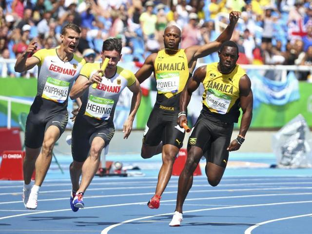 Asafa Powell (JAM) of Jamaica and his teammate Nickel Ashmeade (JAM) of Jamaica compete at Rio 2016.