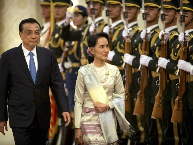 Myanmar's State Counsellor Aung San Suu Kyi (left) and Chinese Premier Li Keqiang talk during a signing of agreements ceremony at the Great Hall of the People in Beijing on Thursday.