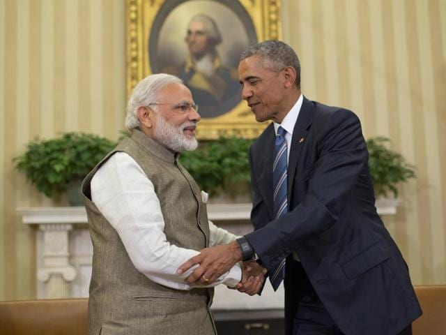 Prime Minister Narendra Modi and US President Barack shake hands before their meeting in the Oval Office of the White House in Washington.