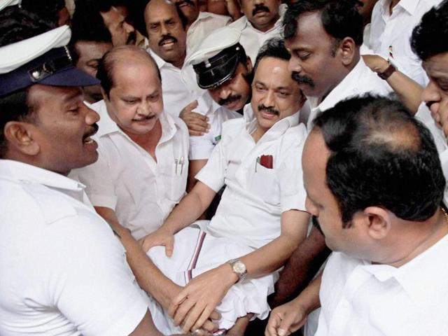 DMK leader MK Stalin being evicted from the assembly in Chennai on Wednesday.