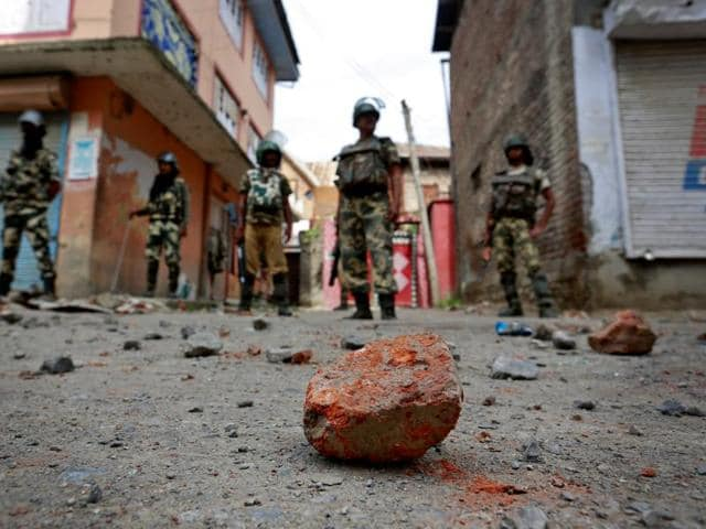 Stones thrown by protestors litter the street in Srinagar as security forces enforce a curfew following weeks of violence in Kashmir.
