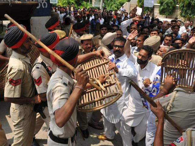 Police stopping BSP workers from entering the office of the SSP (rural) in Jalandhar on Wenesday.