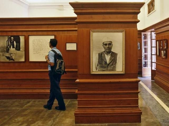A visitor stands next to a portrait of country's first prime minister Jawaharlal Nehru inside the Nehru memorial Museum and Library in Delhi.