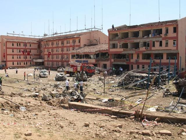 Officials work at the blast scene after a car bomb attack on a police station in the eastern Turkish city of Elazig.