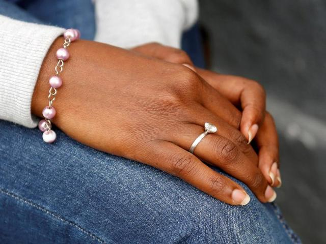 The hands of Eritrean migrant Ruta Fisehaye are seen as she poses for a photograph in Catania, Italy.