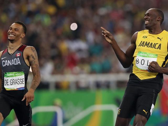 Jamaica's Usain Bolt and Canada's Andre De Grasse, left.
