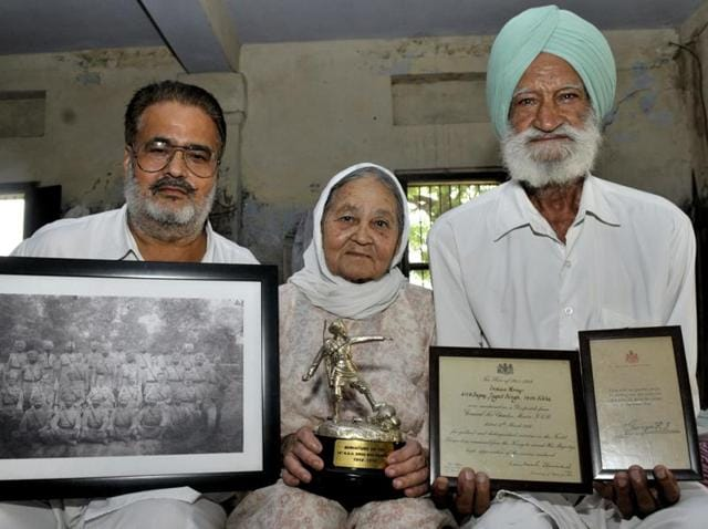(From right) Gurcharan Singh and Gurcharan Kaur with their son.