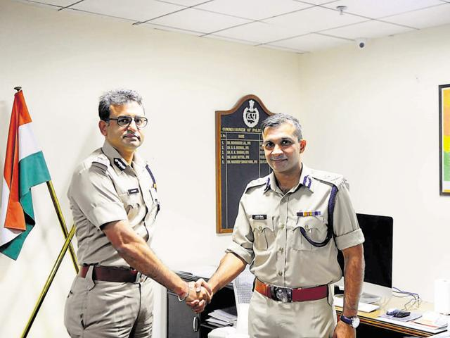 Sandeep Khirwar (right) takes over as the police commissioner of Gurgaon from Navdeep Singh Virk at the commissioner's office on Wednesday evening.